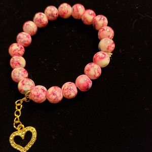 Pink beaded bracelet with heart